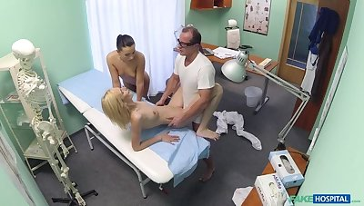 Doctor and nurse round out up and pleasure married patient
