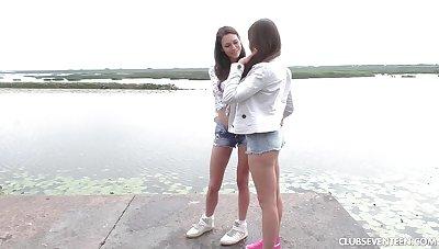 Lesbian best friends pleasuring their wet pussies in outdoors