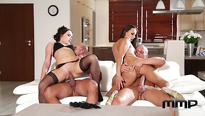 Married women metamorphosis their men in a fantastic couch foursome
