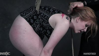 Horny master puts a bootylicious babe in some nice bondage