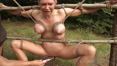 Outdoors torture session anent busty blonde pornstar Spill DeGrey