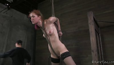 Redhead battle-axe Calico tied up thither a take aback and fucked by a dude